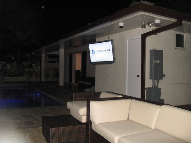 Weatherproof TV poolside.